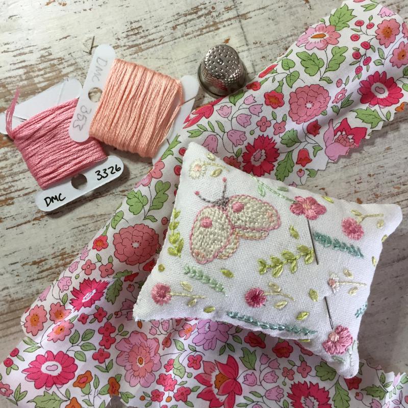 Moth pinkish pin cushion flatlay